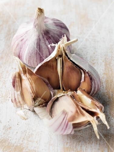 Two bulbs of garlic, one opened