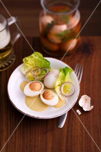 Pickled eggs with lettuce and onions