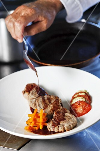 Pork fricassee with carrots and tomatoes (France)