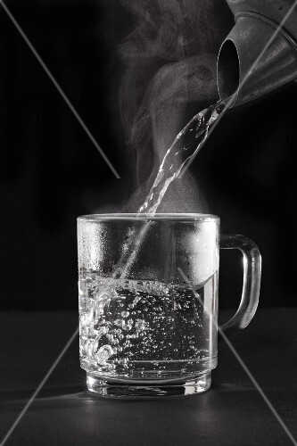 Hot water being poured into a glass