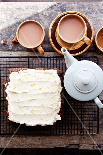 Carrot cake with orange and cream cheese frosting served with tea