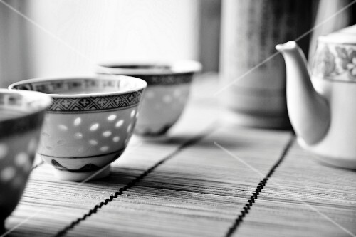 Chinese tea crockery on a bamboo mat (black and white image)