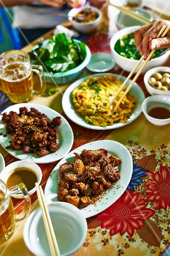 A Vietnamese meal featuring fried mountain goat and omelette