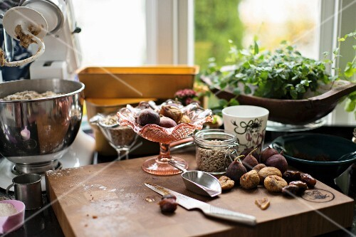 Various breakfast ingredients (roll dough, figs, dates) in a kitchen