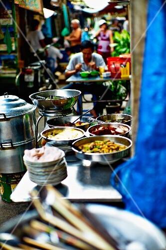 A street bar at a market in Saigon (Vietnam)