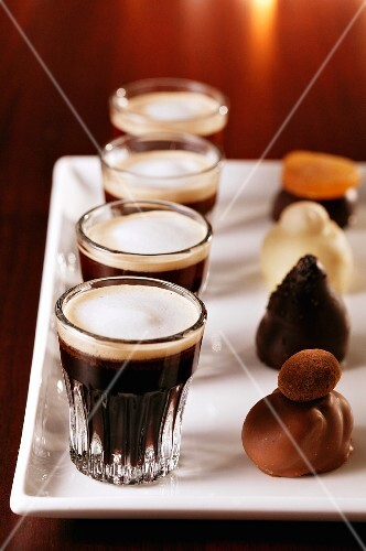 Glasses of espresso and pralines on a tray