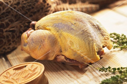 A raw, plucked pheasant ready to roast