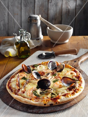 A seafood and cheese pizza