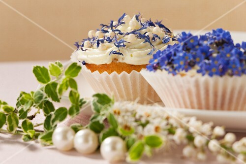 Cupcakes decorated with spring flowers for a wedding