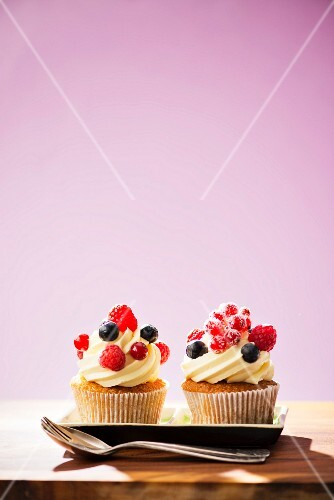 Cupcake decorated with buttercream and fresh berries