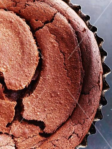 Freshly baked chocolate cake in a baking tin (detail)