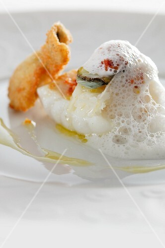Monk fish and an oyster with foam sauce