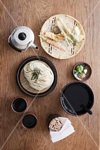 An arrangement of tempura, rice noodles and green tea