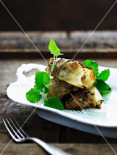 Cabbage roulade with mint leaves