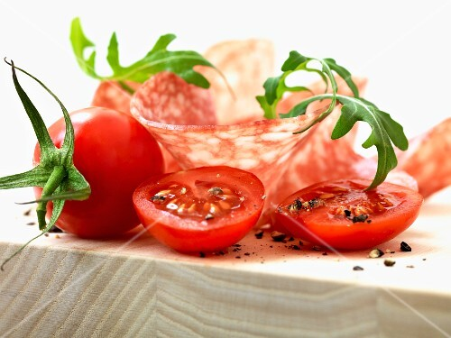 Tomatoes with slices of salami and rocket