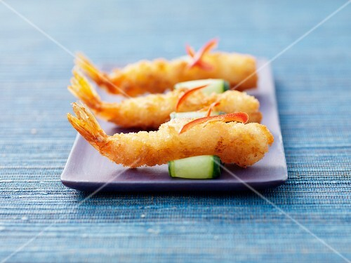 Prawn tempura on cucumber slices