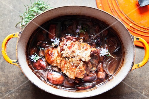 Lamb braised in red wine with onions, garlic and rosemary