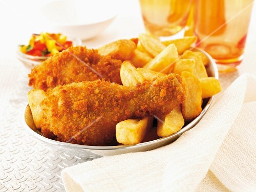 Breaded chicken drumsticks with chips and salad