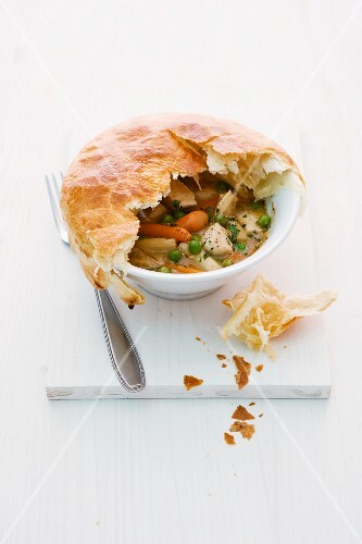 Chicken fricassee with a puff pastry lid