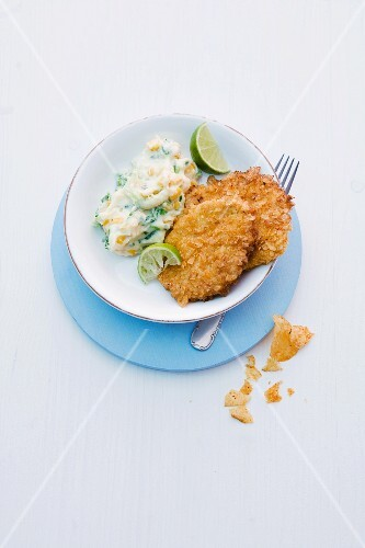 Turkey escalope with a crisp coating served with mashed potatoes