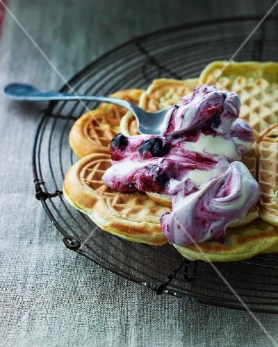 Sweet waffles with blueberry cream on a wire rack