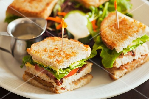 Vegan club sandwich with seitan, tomatoes and lettuce