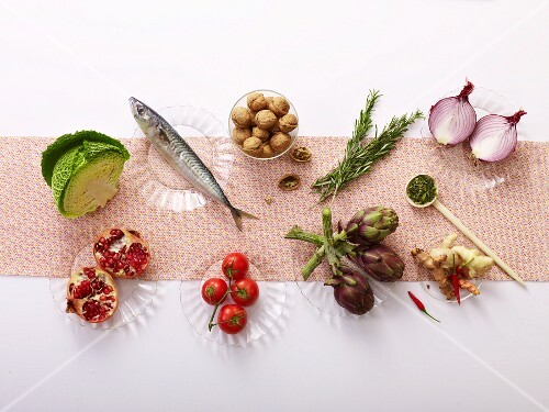 Various anti-inflamatory foods on glass plates seen from above