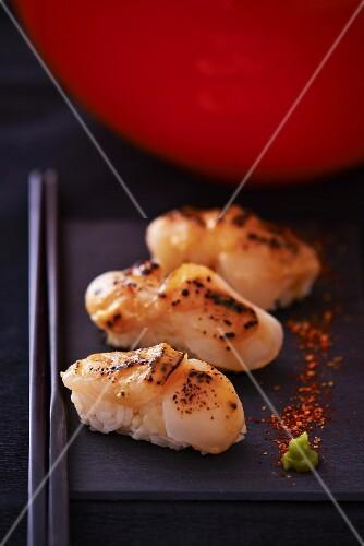 Nigiri sushi with fried scallops