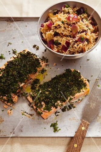 Salmon fillet with a herb coating served with a rice salad