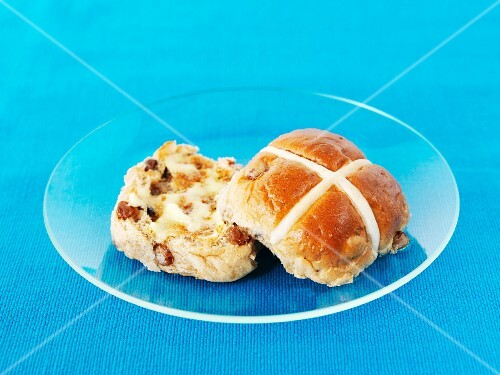 A hot cross bun with butter