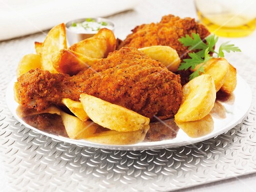 Chicken legs with a spicy coating and potato wedges