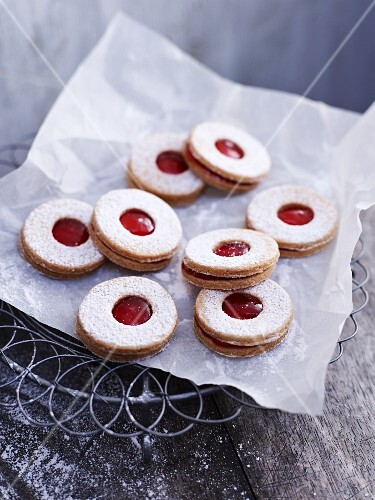 Jammy shortbread biscuits on a piece of paper