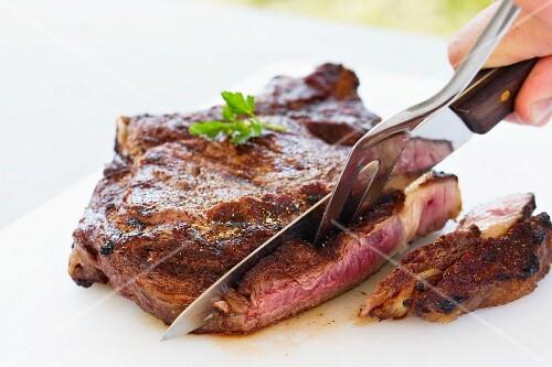 Beefsteak being sliced