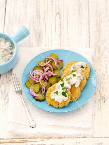 Barley cakes with mushrooms and gherkins