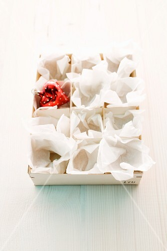 A box of red heart decorations