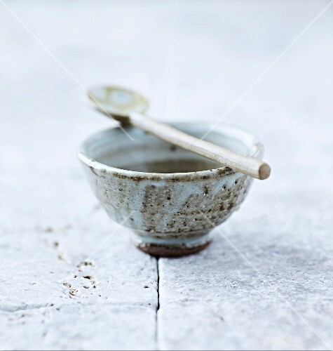A traditional Japanese ceramic tea bowl and spoon