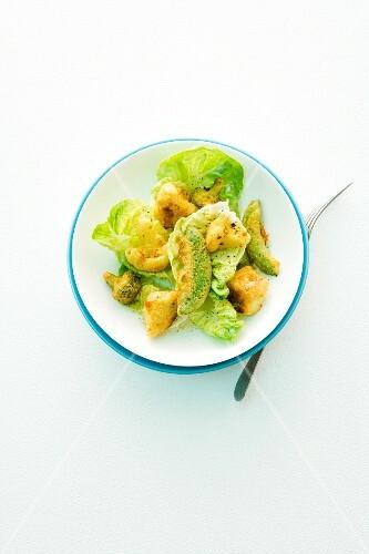 Fried curried vegetables on lettuce leaves