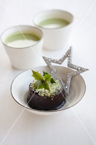 Chocolate cake filled with matcha tea cream for Christmas