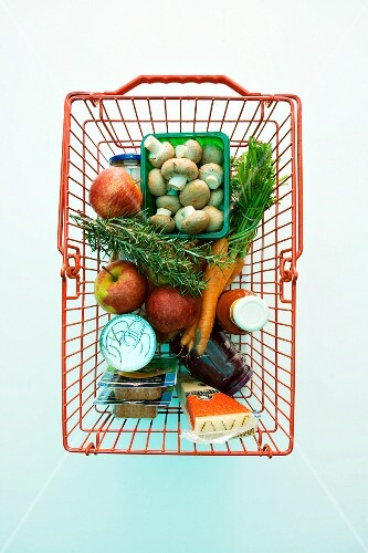 Fresh and packaged groceries in a shopping basket