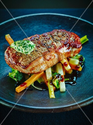 Beef steak with vegetables and herb butter