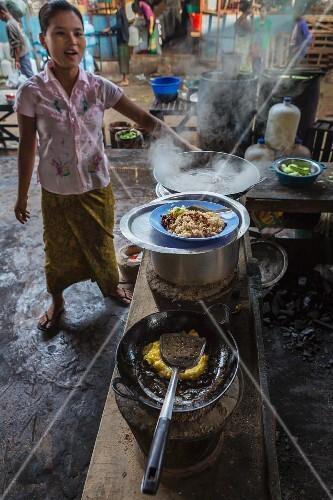 A breakfast bar at a market in Myanmar