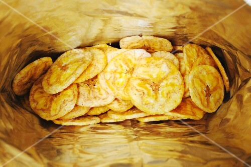 A bag of dried banana chips (seen from above)