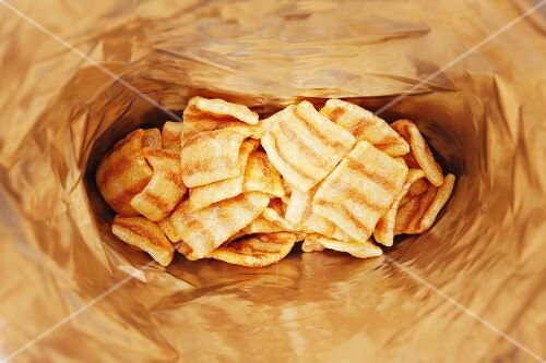A bag of bacon flavour wheat crisps (seen from above)