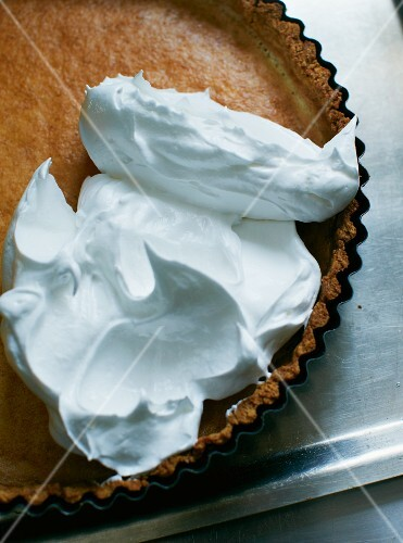 Lemon tart topped with unbaked meringue