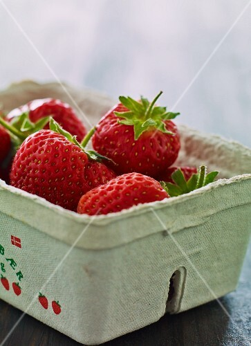 Fresh strawberries in a paper punnet