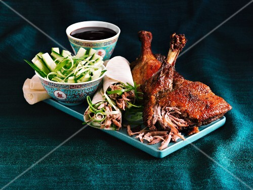 Crispy Peking duck and duck wraps with a cucumber salad and a soy sauce dip
