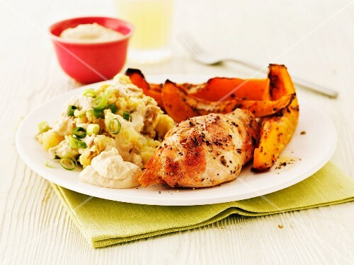 Roast chicken breast with potato salad and roast pumpkin wedges