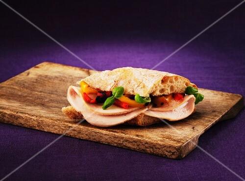 A turkey, roast pepper and basil sandwich