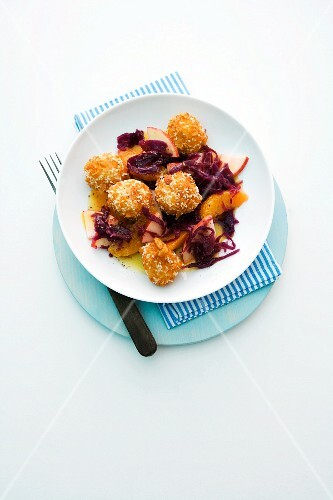 Sesame seed dumplings with apple red cabbage