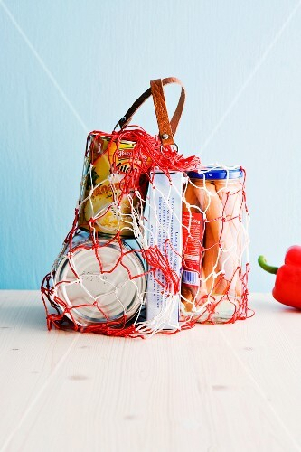 Various groceries in a net shopping bag